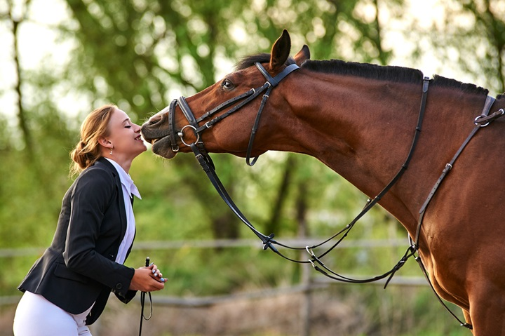 Rider communicating with her horse.